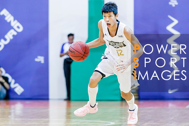 Ho Kuen Chun #12 of Eagle Basketball Team dribbles the ball up court against the Nam Ching during the Hong Kong Basketball League game between Eagle and Nam Ching at Southorn Stadium on June 22, 2018 in Hong Kong. Photo by Yu Chun Christopher Wong / Power Sport Images