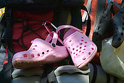 Pink water shoes strapped to backpack in the White Mountains, New Hampshire USA