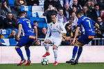 Lucas Vazquez (C) of Real Madrid competes for the ball with Ruben Duarte (L) and Ruben Sobrino Pozuelo of Deportivo Alaves during the La Liga 2017-18 match between Real Madrid and Deportivo Alaves at Santiago Bernabeu Stadium on February 24 2018 in Madrid, Spain. Photo by Diego Souto / Power Sport Images
