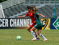 St. Louis Athletica forward Angie Woznuk (11) pressures Washington Freedom midfielder Homare Sawa (10) during a WPS match at Anheuser-Busch Soccer Park, in Fenton, MO, June 20 2009. Washington  won the match 1-0.