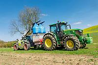 Loading bagged nitrogen into the fertilser spreader - Northamptonshire, April