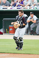 Kannapolis Intimidators catcher Brett Austin (10) chases down a wild pitch during the game against the Delmarva Shorebirds at CMC-NorthEast Stadium on July 3, 2014 in Kannapolis, North Carolina.  The Shorebirds defeated the Intimidators 6-5. (Brian Westerholt/Four Seam Images)