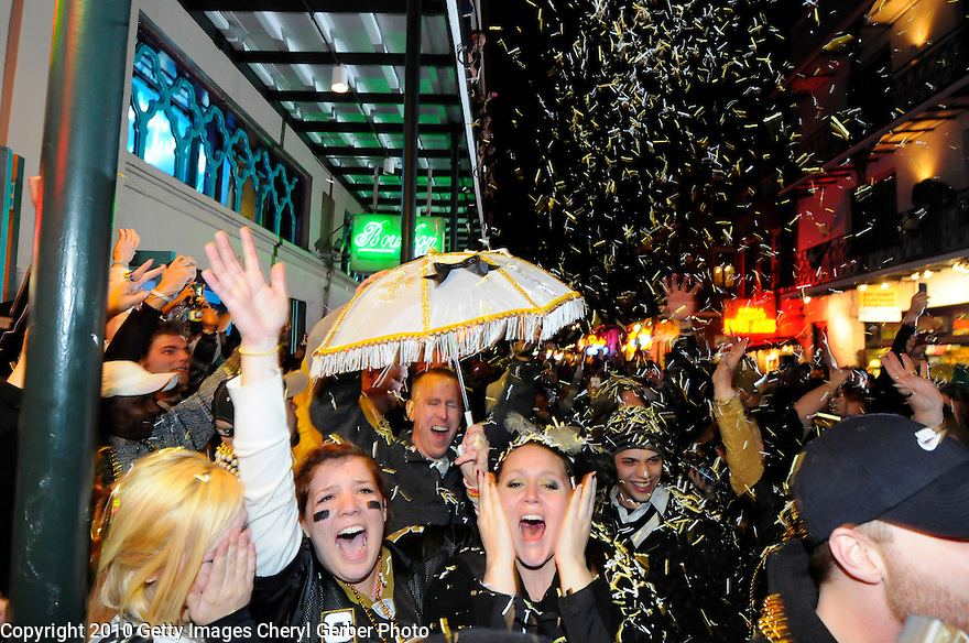 NEW ORLEANS - FEBRUARY 07:  New Orleans Saints fans celebrate the team's win against the Indianapolis Colts during Super Bowl XLIV on Bourbon Street in the French Quarter on February 7, 2010 in New Orleans, Louisiana.  The Saints won 31-17. (Photo by Cheryl Gerber/Getty Images)
