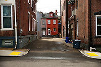 An empty side street is shown on Friday March 20, 2020 in the Lawrenceville neighborhood of Pittsburgh, Pennsylvania. (Photo by Jared Wickerham/Pittsburgh City Paper)