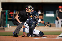 Charleston RiverDogs catcher Michael Bergland (15) frames a pitch as home plate umpire Matt Blackborow looks on during the game against the Down East Wood Ducks at Joseph P. Riley, Jr. Park on September 26, 2021 in Charleston, South Carolina. (Brian Westerholt/Four Seam Images)