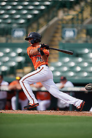 Baltimore Orioles designated hitter Alexis Torres (36) follows through on a swing during a Florida Instructional League game against the Pittsburgh Pirates on September 22, 2018 at Ed Smith Stadium in Sarasota, Florida.  (Mike Janes/Four Seam Images)