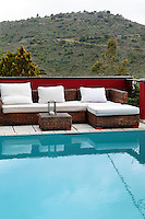 outdoor living room in the pool area