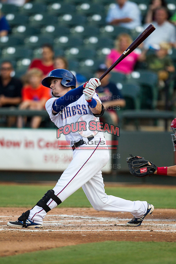 Round Rock Express first baseman Ryan Rua (12) follows through on his swing during the second game of a Pacific Coast League doubleheader against the Memphis Redbirds on August 3, 2014 at the Dell Diamond in Round Rock, Texas. The Redbirds defeated the Express 7-6. (Andrew Woolley/Four Seam Images)