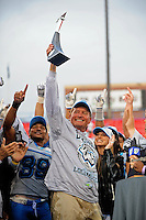 Nov. 27, 2009; Las Vegas, NV, USA; Las Vegas Locomotives head coach Jim Fassel lifts the WIlliam Hambrecht Championship Trophy as he celebrates after defeating the Florida Tuskers during the UFL championship game at Sam Boyd Stadium. The Locomotives defeated the Tuskers 20-17 in overtime. Mandatory Credit: Mark J. Rebilas-