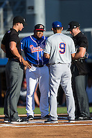 Danville Braves manager Robinson Cancel (38) meets with Kingsport Mets manager Luis Rivera (9) and umpires Dillon Wilson (left) and Matthew Brown (right) prior to the start of their Appalachian League game at American Legion Post 325 Field on July 9, 2016 in Danville, Virginia.  The Mets defeated the Braves 10-8.  (Brian Westerholt/Four Seam Images)