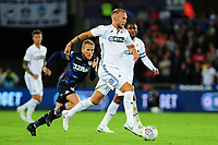 Mike van der Hoorn of Swansea City vies for possession with Samuel Saiz of Leeds United during the Sky Bet Championship match between Swansea City and Leeds United at the Liberty Stadium, Swansea, Wales, UK. Tuesday 21 August 2018