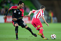 MELBOURNE, AUSTRALIA - NOVEMBER 19: Josip Skoko of the Heart and Marcos Flores of Adelaide in action during the round 15 A-League match between the Melbourne Heart and Adelaide United at AAMI Park on November 19, 2010 in Melbourne, Australia (Photo by Sydney Low / Asterisk Images)