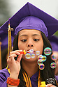 More than 390 students crossed the stage Friday night for the North Kitsap High School graduation. Justina Garcia blows bubbles during a light moment at graduation. (Brad Camp/ Olympic Photo Group)