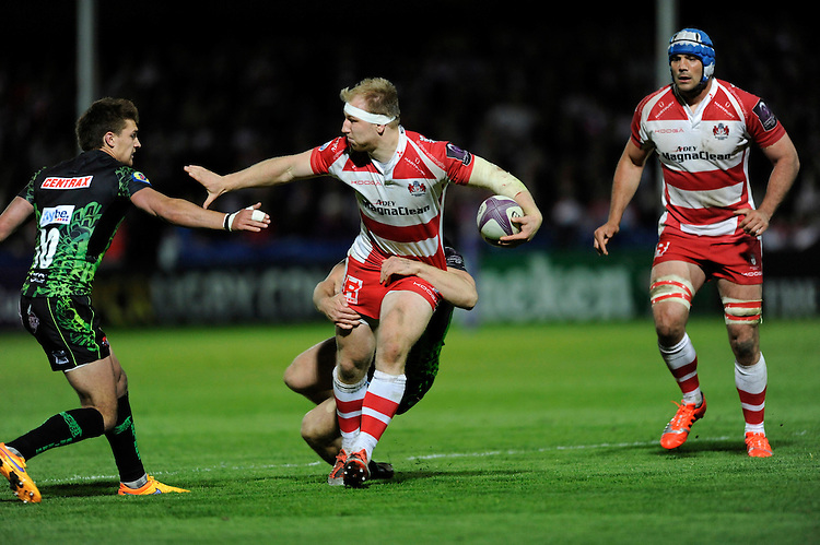 Matt Kvesic of Gloucester Rugby looks to hand off Henry Slade of Exeter Chiefs during the European Rugby Challenge Cup semi final match between Gloucester Rugby and Exeter Chiefs at Kingsholm Stadium on Saturday 18th April 2015 (Photo by Rob Munro)