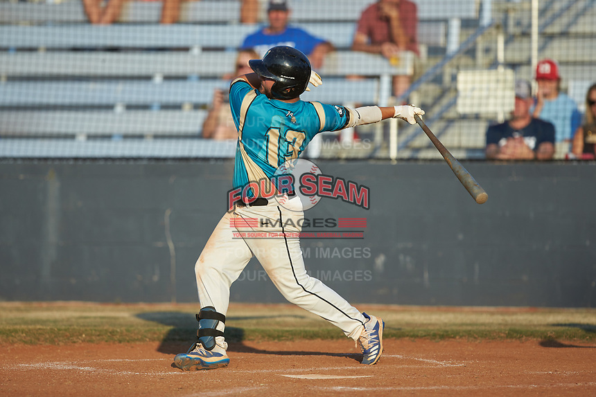 Jonathan Perez (13) (UNC Asheville) of the Mooresville Spinners follows through on his swing against the Dry Pond Blue Sox at Moor Park on July 2, 2020 in Mooresville, NC.  The Spinners defeated the Blue Sox 9-4. (Brian Westerholt/Four Seam Images)