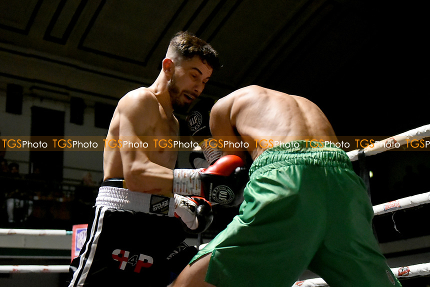 Krzysztof Zuraw (black shorts) defeats Lee Devine during a Boxing Show at York Hall on 11th September 2021