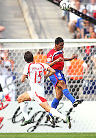 Michael Umana (4) of Costa Rica heads the ball away from Ebi Smolarek (15) of Poland. Poland defeated Costa Rica 2-1 in their FIFA World Cup Group A match at FIFA World Cup Stadium, Hanover, Germany, June 20, 2006.