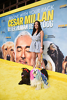 """LOS ANGELES - JULY 30: Karen Gunther Chung and Mistricks attend the premiere event for National Geographic's """"Cesar Millan: Better Human, Better Dog"""" at the Westfield Century City Mall Atrium on July 30, 2021 in Los Angeles, California. (Photo by Stewart Cook/National Geographic/PictureGroup)"""