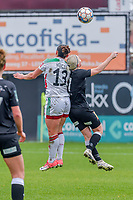 Sara Yuceil (13) of OHL and Stephanie Van Gils (27) of Eendracht Aalst pictured during a female soccer game between Eendracht Aalst and OHL on the 13 th matchday of the 2020 - 2021 season of Belgian Scooore Womens Super League , Saturday 6 th of February 2021  in Aalst , Belgium . PHOTO SPORTPIX.BE | SPP | STIJN AUDOOREN