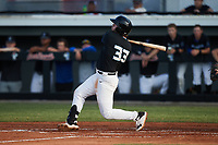 Nathan Ackenhausen (33) (Eastern Oklahoma State) of the Bluefield Ridge Runners follows through on his swing against the Burlington Sock Puppets at Burlington Athletic Park on June 8, 2021 in Burlington, North Carolina. (Brian Westerholt/Four Seam Images)