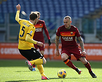 Football, Serie A: AS Roma -  Udinese, Olympic stadium, Rome, February 14, 2021. <br /> Roma's Rick Karsdorp (r) in action with Udinese's Thomas Ouwejan (r) during the Italian Serie A football match between Roma and Udinese at Rome's Olympic stadium, on February 14, 2021.  <br /> UPDATE IMAGES PRESS/Isabella Bonotto