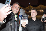 """© Joel Goodman - 07973 332324 . 03/11/2017 . Manchester , UK . LUTZ BACHMANN , founder of the PEGIDA movement poses with TOMMY ROBINSON (real name Stephen Yaxley-Lennon ) at the launch of the former EDL leader's book """" Mohammed's Koran """" at Castlefield Bowl . Originally planned as a ticket-only event at Bowlers Exhibition Centre , the launch was moved at short notice to a public location in the city . Photo credit : Joel Goodman"""