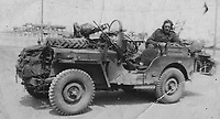 BNPS.co.uk (01202) 558833. <br /> Pic: Bosleys/BNPS<br /> <br /> Pictured: A member of the SAS poses for a photograph with his Jeep. <br /> <br /> Never before seen photos taken by a fishmonger turned SAS hero behind enemy lines in World War Two have come to light 76 years on.<br /> <br /> Sergeant Samuel Rushworth, of the 2nd Special Air Service, was dropped into occupied France two days before D-Day in June 1944.<br /> <br /> They were tasked with disrupting German reinforcements dispatched to Normandy following the Allied landings.