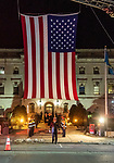 WATERBURY, CT. 20 December 2019-122019BS243 - Soon to be new Waterbury Fire Chief Terry Ballou walks under the large American flag as he crosses the street, during the Fire Chief swearing in ceremonies at City Hall on Friday. Terry Ballou replaces former Fire Chief David Martin, who retired earlier this year. Bill Shettle Republican-American