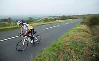 27 SEP 2013 - DARTMOOR, GBR - Rod Elder climbs the hill onto Dartmoor, Devon, Great Britain during the bike leg of the Enduroman 2013 Lands End to London to Dover ultra triathlon (PHOTO COPYRIGHT © 2013 NIGEL FARROW, ALL RIGHTS RESERVED)