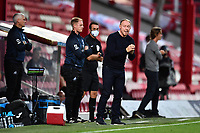 Steve Cooper Head Coach of Swansea City shouts instructions to his team from the dug-out during the Sky Bet Championship Play Off Semi-final 2nd Leg between Brentford and Swansea City at Griffin Park in Brentford, England, UK. 29th July, 2020