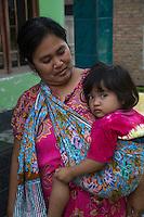 Borobudur, Java, Indonesia.  Javanese Mother and Daughter, in a Shoulder-sling.