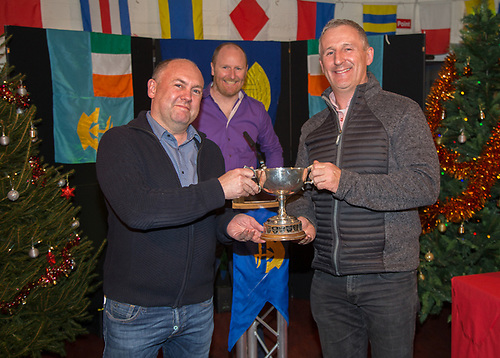 Fergal Lyons presenting Liam Burke, Tribal receiving the Spring Cup - Galway Bay Sailing Club 50th - Anniversary Awards night.