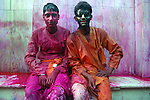 Two local boys after playing holi at Krishna temple at Nandgaon 5 kms away from Barsana on the 2nd day of lathmar holi, Uttar Pradesh, India . Lathmar holy is celibrated 7 days before the actual holi day.