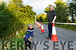 Bertie  Curtin and Cllr Michael Gleeson at the road in Kilcummin which is subsiding