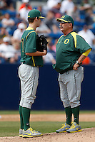 Oregon Ducks Head Coach George Horton #8 talks to pitcher Cole Irvin #19 during a baseball game against the Cal State Fullerton Titans at Goodwin Field on March 3, 2013 in Fullerton, California. (Larry Goren/Four Seam Images)