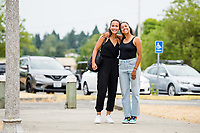 TACOMA, WA - JULY 31: Sam Hiatt #27 and Madison Hammond #99 of the OL Reign arrive at the stadium before a game between Racing Louisville FC and OL Reign at Cheney Stadium on July 31, 2021 in Tacoma, Washington.