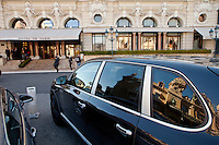 L'Hotel de Paris, Casino Square, Monte Carlo, Monaco, 21 March 2013. The Casino de Monte Carlo can be seen reflected in the car's windows.