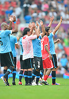 July 26, 2012..Players of URU and UAE team wave at the supporters at the conclusion of 2012 London Olympics group A Football match between United Arab Emirates and Uruguay at Old Trafford in Manchester, England, Uruguay defeat United Arab Emirates 2-1...