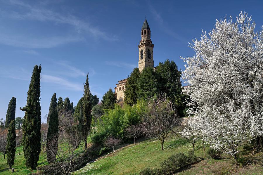 Spring blossoming tree and gardens, Tempio dei Caduti, Bergamo, Italy