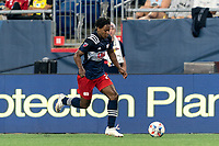FOXBOROUGH, MA - AUGUST 18: DeJuan Jones #24 of New England Revolution brings the ball forward during a game between D.C. United and New England Revolution at Gillette Stadium on August 18, 2021 in Foxborough, Massachusetts.