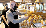 WOLCOTT CT. - 13 January 2020-011321SV03-Bill Zhuta, owner, works behind the counter at Wolcott Bagels in Wolcott Wednesday. The new business sells bagels made in Waterbury by Ami's Crispy Bagels.<br /> Steven Valenti Republican-American