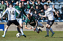 Hib's Liam Fontaine is brought down by Raith Rovers' Lewis Vaughan