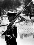 Soldier stands guard in snow Arlington National Cemetery, Arlington National Cemetery Virginia is a military cemetery in the United States,