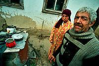 Tiraspol / Transnistria.<br /> Per le famiglie povere e numerose la vita è dura e si rimpiangono i tempi della vecchia Unione Sovietica. L'alcolismo dilaga e i bambini vengono spesso affidati agli 'internat'.Nella foto, l'anziano Ivan Penova e la figlia Elena, disabile. Vivono dei pochi contributi sociali distribuiti dal sindaco alle famiglie bisognose. La casa è fatiscente, senza acqua e senza riscaldamento.Le condizioni di vita diventano ancor più dure durante i mesi invernali quando il termometro scende a 30 gradi sotto zero.<br /> Foto Livio Senigalliesi