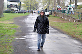 Jody Petty tries to stay dry before the Middleburg races begin.