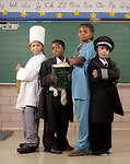 (DENVER, CO  July 27, 2004)  Kids from Mitchell Elementary School pose as professionals.   Left to right:  Adriana Robledo, 10, 5th grade; Tyrone Catholic, 9, 4th grade; Nakia Robinson, 9, 5th grade;  and Isaac Reynoso, 9, 4th grade. Clothing courtesy of Morton's, The Steakhouse, (cq, that's how it's called, Morton's, The Steakhouse), Frontier Airlines, Kaiser Permanente, and Steve Katich (president of the Denver Public Schools Foundation, and Ellen's husband--this is full disclosure if you want to leave his name or title out) (photo by ELLEN JASKOL/ROCKY MOUNTAIN NEWS)