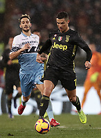 Football, Serie A: S.S. Lazio - Juventus, Olympic stadium, Rome, January 27, 2019. <br /> Juventus' Cristiano Ronaldo (r) in action with Lazio's Luis Alberto Romero Alconchel (l) during the Italian Serie A football match between S.S. Lazio and Juventus at Rome's Olympic stadium, Rome on January 27, 2019.<br /> UPDATE IMAGES PRESS/Isabella Bonotto