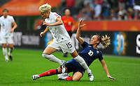 Megan Rapinoe (l) of team USA and Camille Abily of team France during the FIFA Women's World Cup at the FIFA Stadium in Moenchengladbach, Germany on July 13th, 2011.