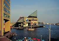 Baltimore MD's Inner Harbor with the Aquarium and floating museum the submarine USS Torsk. Historical. Baltimore Maryland USA.