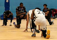 Emondre Rickman of Surrey Scorchers takes a knee prior to the tip off during the BBL Championship match between Surrey Scorchers and Newcastle Eagles at Surrey Sports Park, Guildford, England on 20 March 2021. Photo by Liam McAvoy.
